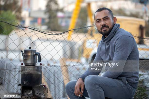 syrian man - refugee camp stock pictures, royalty-free photos & images