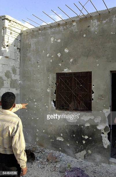 Syrian man points 03 September 2005 at the hideout where five members of the Islamist militant group Jund alSham were killed in clashes with Syrian...