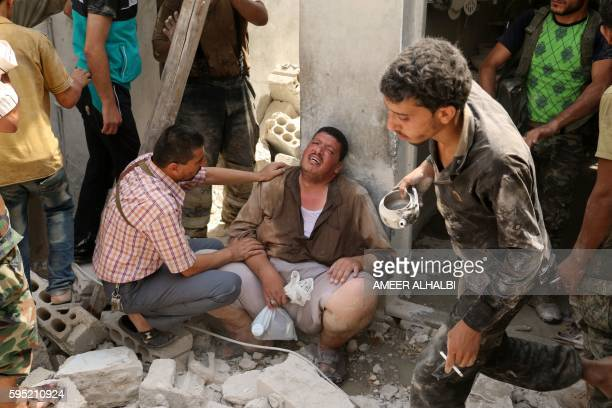 A Syrian man reacts in the rubble of buildings following a barrel bomb attack on the Bab alNairab neighbourhood of the northern Syrian city of Aleppo...