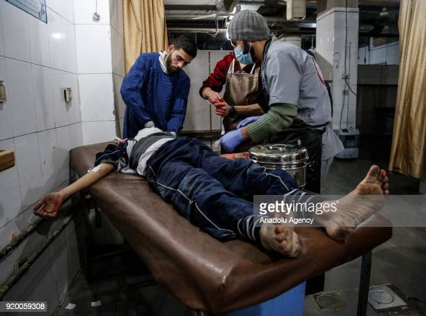 Syrian man receives medical treatment after war planes belonging to Assad Regime carried out airstrikes at the residential areas of Kafr Batna town...