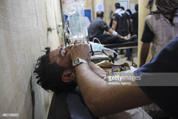 Syrian man receives treatment at a field hospital following a chlorine gas attack by Assad regime forces in Ayn Tarma town of Damascus Syria on July...