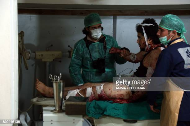 A Syrian man receives treatment at a makeshift hospital in Zamalka near Syria's capital Damascus on December 14 following reported shelling / AFP...