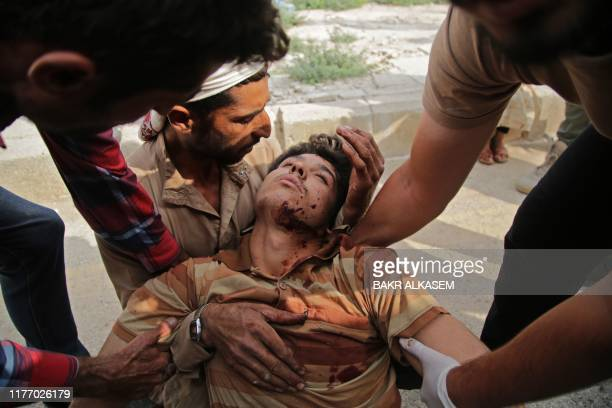 Syrian man receives treatment on October 20 in the Syrian border town of Tal Abyad which was seized by Turkey-backed forces last week.