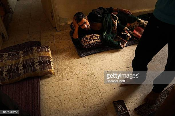 Syrian man rests in the apartment he shares with other Syrian refugees in a poor section of Beirut where the majority of residents are Syrian...