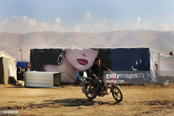 Syrian man rides his motorcycle in a makeshift camp occupied by Syrian refugees in the Bekaa Valley, close to the border with Syria on November 11,...