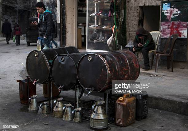 A Syrian man sells fuel in the northern embattled Syrian city of Aleppo on February 9 2016 Shop shelves are bare and prices have doubled in Syria's...