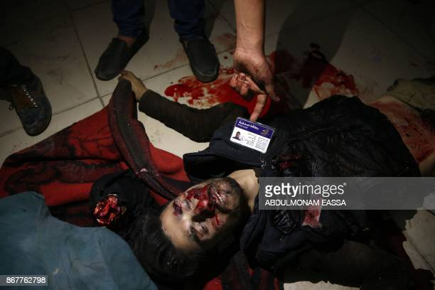 A Syrian man shows the press card of Qais AlQadi who was reportedly killed in shelling by Syrian government forces in the rebelheld town of Hamouria...