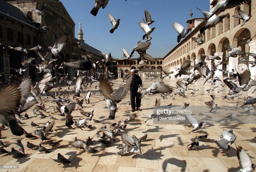 A Syrian man walks in front of the histo : News Photo