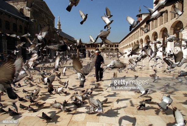 A Syrian man walks in front of the historic Umayyad mosque in the old city of Damascus 10 February 2001 AFP PHOTO/Louai BESHARA