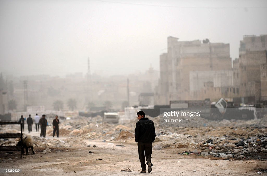 A Syrian man walks past destruction in the northern city of Aleppo on March 22, 2013. The UN lamented the escalating violence in Syria and extended a probe into widespread human rights violations in the war-torn country.
