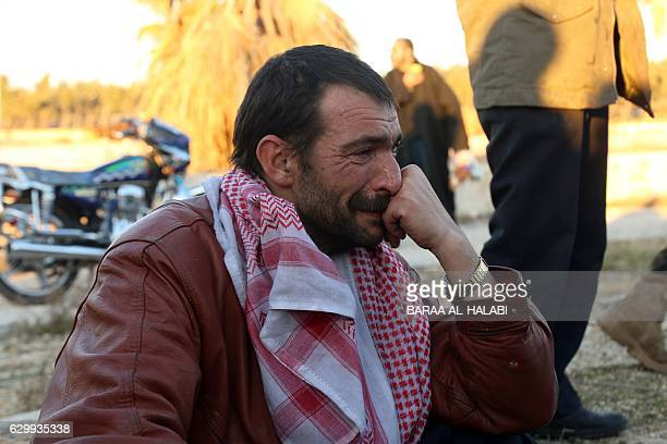 Syrian man who was evacuated from rebelheld neighbourhoods in the embattled city of Aleppo cries upon his arrival in the oppositioncontrolled Khan...