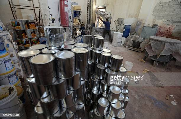 Syrian man works at a rehabilitated paint factory in Aleppo's industrial area in the government controlled side of the wartorn northern Syrian city...