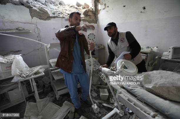 Syrian medics check the damage at the Sham Surgical hospital one of several hospitals targeted by air strikes in Idlib province over the past few...