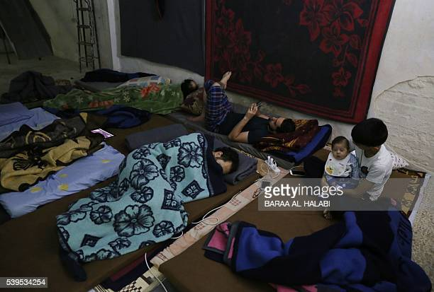 Syrian men and youth sleep in an underground shelter where they take cover at night from shelling in the rebelheld Kalasa neighbourhood of the...