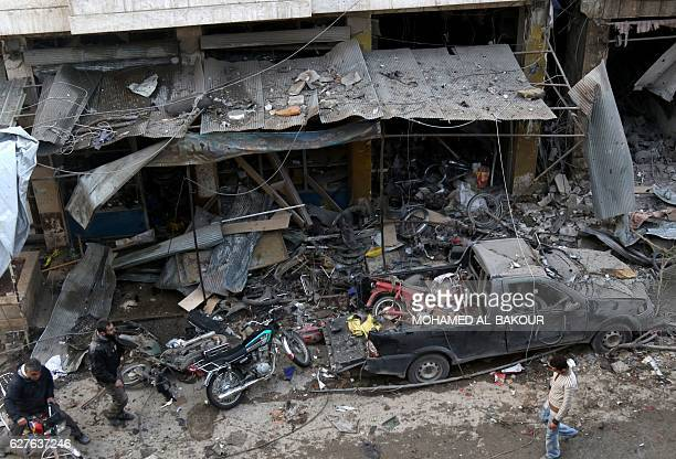 TOPSHOT Syrian men inspect the damage following an air strike on the village of Maaret alNuman in the country's northern province of Idlib on...