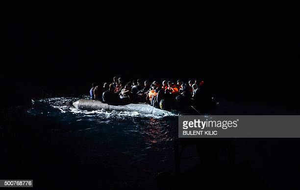 Syrian migrants aboard an inflatable dinghy are about to be rescued while attempting to reach the Greek Island Chios on the Agean Sea near Izmir in...