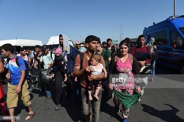 Syrian migrants and refugees march along the highway towards the TurkishGreek border at Edirne on September 18 2015 Several hundred migrants who have...
