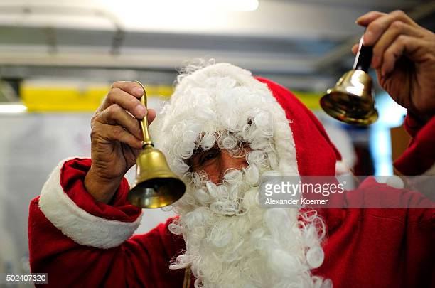 Syrian migrants dressed as Santa Claus prepares himself at a shelter for migrants and refugees on December 24 2015 in Sarstedt Germany Thousands of...