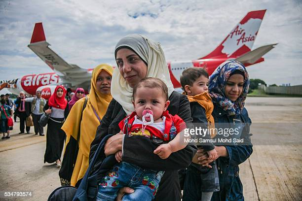 Syrian migrants from the Bekka Valley refugee camp in Lebanon arrive with their children at the Royal Malaysian Air Force Base on May 28 2016 in...