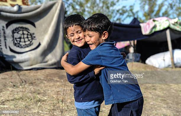 Syrian migrants Nafi Abu and Abdurrahman Abu from Aleppo hug each other on the side of a highway near Edirne as they rest from their travel towards...
