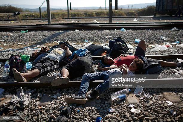 Syrian migrants sleep on railroad tracks waiting to be processed across the Macedonian border September 2 2015 in Idomeni Greece Since the beginning...