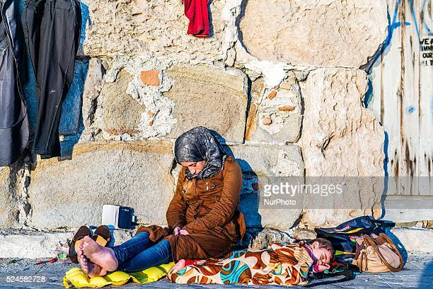 Syrian mother and child sleeping at the harbour on August 31 2015 Kos Island Greece Ulrik Pedersen
