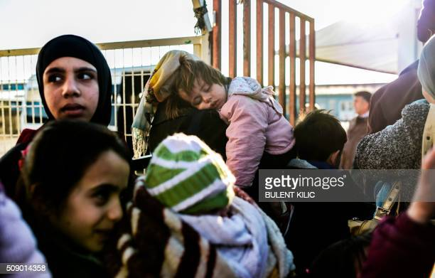 Syrian mothers and children wait to return to Syria on February 8 2016 at the Turkish Oncupinar border gate near Kilis southerncentral Turkey...