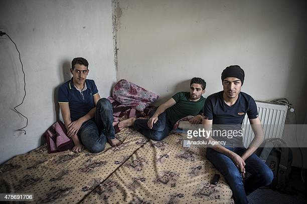 Syrian Muhammad Cibavil Muhammad Ali and Asil Ayyash who fled Syria three months ago are seen at a hotel room in Gaziantep Turkey on June 02 2015...