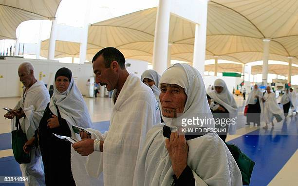 Syrian Muslim pilgrims walk outside the King Abdul Aziz airport upon their arrival to the Red Sea port city of Jeddah on November 27 2008 Muslim...
