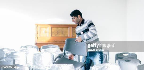 Syrian national Bander Alkorsan works at an accommodation facility for asylum seekers inHoyerswerda Germany 05 December 2015 He is currently...