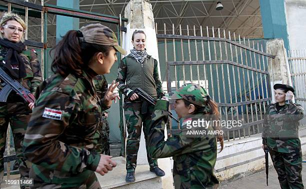 Syrian National Defense force women are seen at a training center in Wadi alDahab in the Syrian city of Homs on January 21 2013 Some 500 women are...