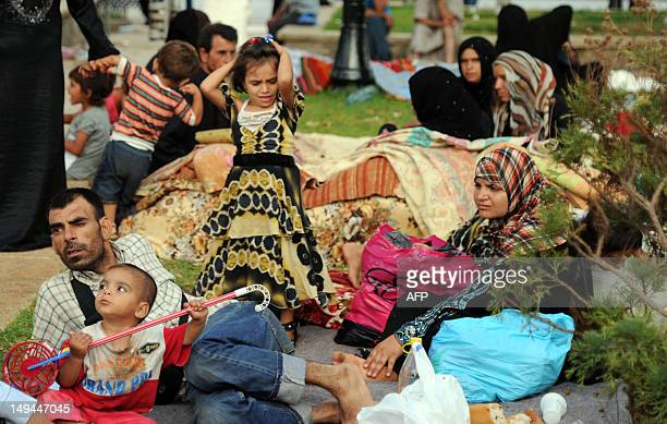 Syrian nationals fleeing the conflict in their home country gather in a garden in Port Said Square in Algiers on July 28 2012 AFP PHOTO/FAROUK BATICHE