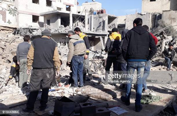 Syrian NGOs and civilians conduct a search and rescue operation on a debris of a destroyed building after Assad Regime carried out airstrikes to...
