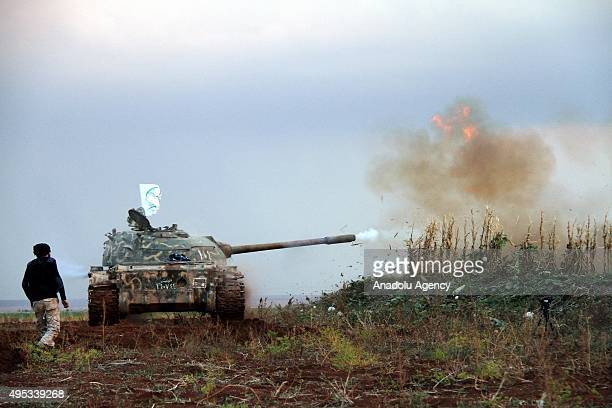 Syrian opponents attack Daesh terrorist organization's positions with a tank in the Herbel village of the Mari district in Aleppo Syria on November 1...