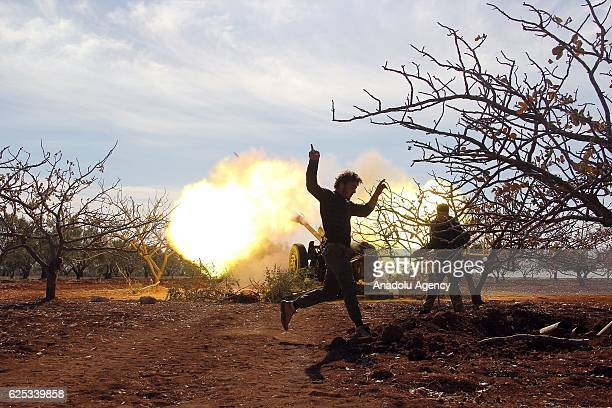 Syrian opponents fire artillery as they attack Assad regime forces near Maan village of Hama Syria on November 23 2016