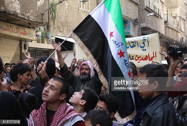 Syrian opponents gathered in the opposition controlled Sakba town stage a protest against the Assad regime and Russia after the Friday prayers in the...