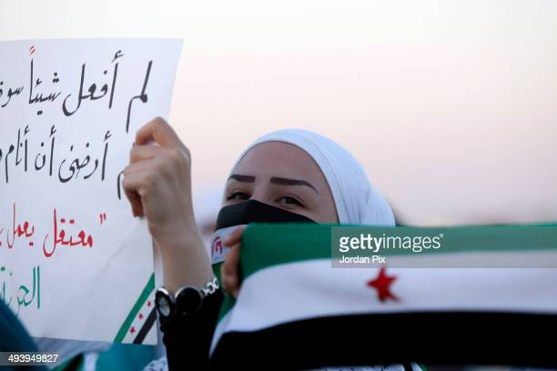 Syrian opposition activist attends a rally in support of the expelling of the Syrian ambassador to Jordan in front of the Syrian embassy May 26 2014...