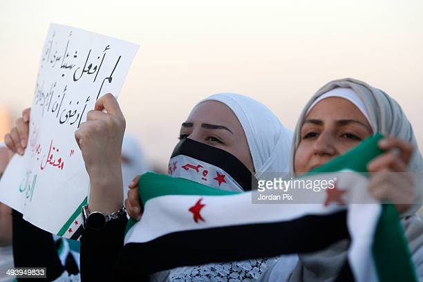 Syrian opposition activists rally in support of the expelling of the Syrian ambassador to Jordan in front of the Syrian embassy May 26 2014 in Amman...