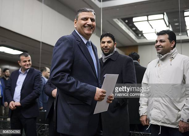 Syrian opposition chief Riad Hijab arrives to a press conference after Syrian peace talks on February 3 2016 in Geneva The UN special envoy for Syria...