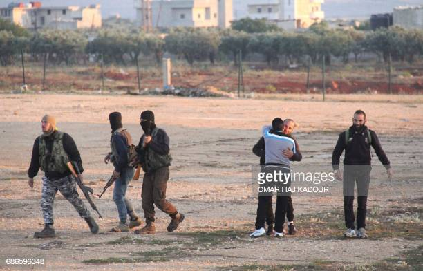 Syrian opposition fighters and their families who were evacuated from the Waer neighbourhood the last oppositionheld district in the central city of...