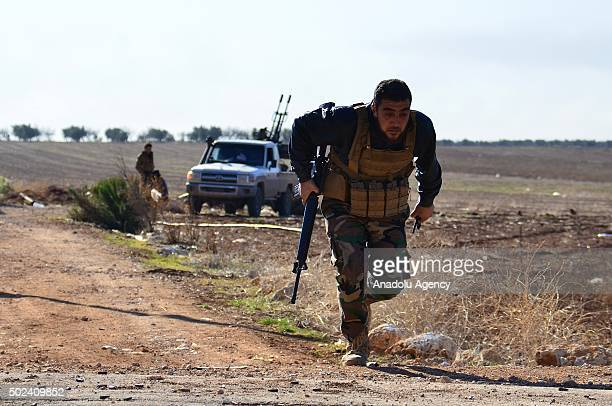 Syrian opposition fighters attack DAESH militants with heavy weapons at Kafr town in Aleppo Syria on December 24 2015