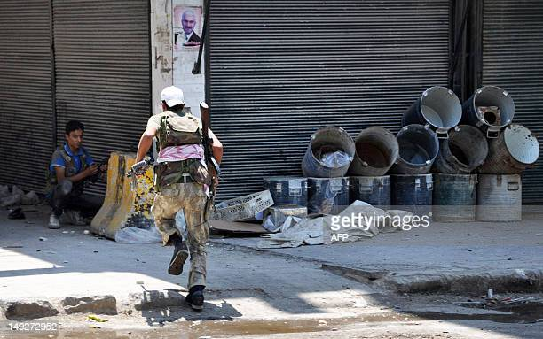 Syrian opposition fighters battle government security forces during the siege of the Shaar district police station in the northern Syrian city of...