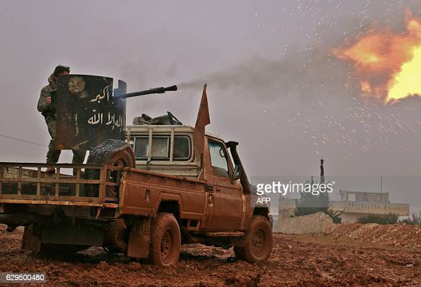 Syrian opposition fighters fire towards positions held by Islamic State group jihadists in al-Bab on the northeastern outskirts of the northern...