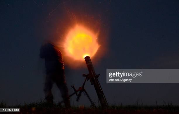 Syrian opposition forces attack Daesh controlled Harbel village with howitzers at Mari district in Aleppo Syria on February 24 2016