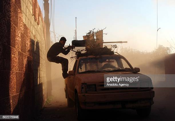 Syrian opposition forces attack regime controlled Merc el Sultan region with heavy weapons at Eastern Ghouta in Damascus Syria on December 22 2015
