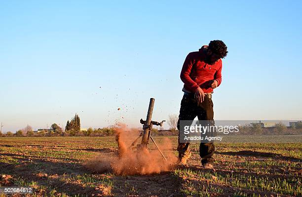 Syrian opposition forces Sultan Murat and Mutasim Brigades attack DAESH militants with heavy weapons at Dudian village in Aleppo Syria on December 27...