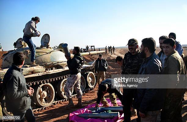 Syrian opposition forces Sultan Murat and Mutasim Brigades prepare to attack DAESH militants with heavy weapons at Dudian village in Aleppo Syria on...