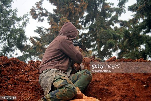 Syrian opposition member stages attack against Assad regime forces near Baskoy in the Handarat area which has a strategic significance in northern...