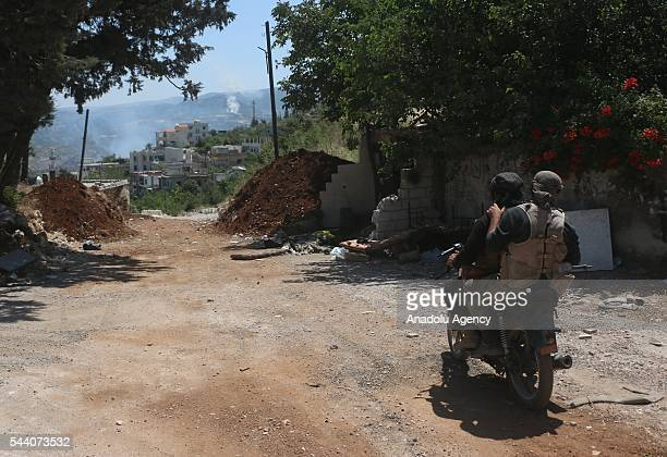 Syrian opposition member stands guard after They took control Kinsabba district of Lattakia Syria on July 1 2016