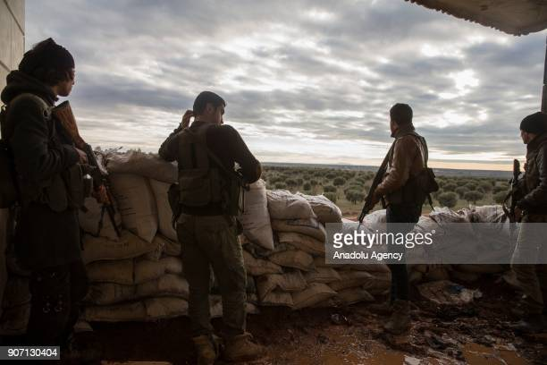 Syrian opposition members keep guard on a bulwark to take action in the nearby city of Afrin for expected Afrin operation against the PYD/PKK targets...